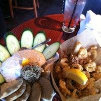 Photo taken at Bar Louie by Monnika M. on 5/12/2012