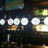 Photo taken at BJ's Restaurant and Brewhouse by Nicki P. on 3/22/2012