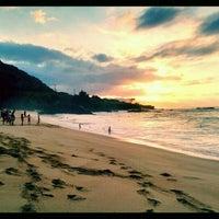 Photo taken at Waimea Bay by Josh N. on 1/2/2012