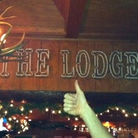 Photo taken at The Lodge Beer and Growler Bar by Reid A. on 12/24/2011