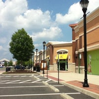 Photo taken at The Shops at White Oak Village by Ronnie B. on 7/9/2011