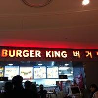 Photo taken at Burger King by 정 유. on 2/29/2012