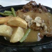 Photo taken at Waroeng Steak & Shake by Dean S. on 9/12/2012