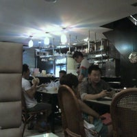 Photo taken at Gilly Cafe (叹茶屋) by poon R. on 1/10/2012