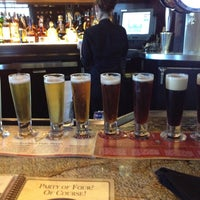 Photo taken at BJ's Restaurant and Brewhouse by Erin G. on 3/15/2012
