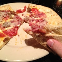 Photo taken at Brixx Wood Fired Pizza by Derek B. on 2/12/2012