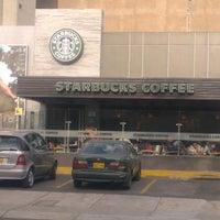 Photo taken at Starbucks Coffee by Petit D. on 10/28/2011