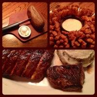 Photo taken at Outback Steakhouse by Leonardo P. on 12/18/2011