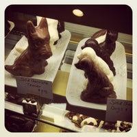 Photo taken at Belgique Chocolatier by Lauren Y. on 4/22/2012