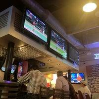 Photo taken at Pluckers Wing Bar by Jordan M. on 3/27/2012