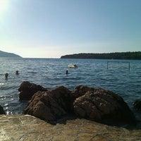 Photo taken at Kraj Lanterne Beach by Danijela M. on 7/20/2012
