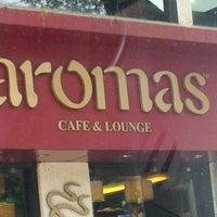 Photo taken at Aromas Cafe by Sanket N. on 4/18/2012