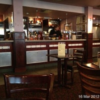 Photo taken at The Central Bar (Wetherspoon) by Roger N. on 3/16/2012