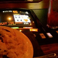 Photo taken at Village Pub & Poker by elusion on 8/14/2011