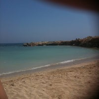 Photo taken at Makronissos beach by Andri K. on 7/10/2011