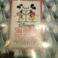 Photo taken at Disney's Soda Fountain & Studio Store by Jenae W. on 2/18/2012