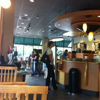 Photo taken at Starbucks by Gloria S. on 6/11/2012