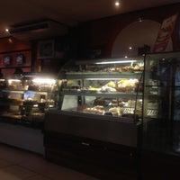 Photo taken at Auguri Café by Rodolfo D. on 3/12/2012
