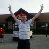 Photo taken at Smokey Bones Bar & Fire Grill by Jos V. on 5/11/2012