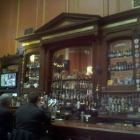Photo taken at Ri Ra Irish Pub and Restaurant by Sarah W. on 12/30/2011