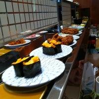 Photo taken at Kulu Kulu Sushi by Pippa A. on 5/4/2011