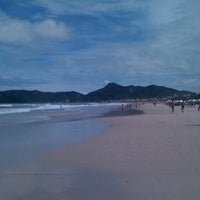 Photo taken at Praia do Mariscal by Charles W. on 1/1/2011