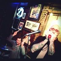 Photo taken at Cat's Eye Pub by Josh F. on 2/19/2012