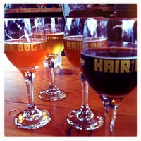 Photo taken at Hair of the Dog Brewery & Tasting Room by Ken B. on 2/12/2011