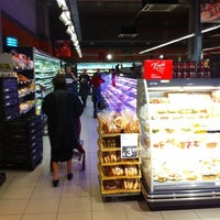Photo taken at Proxy Delhaize by Maxime M. on 12/1/2011