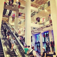Photo taken at UNIQLO 5th Ave by MARiCEL on 7/20/2012