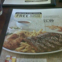 Photo taken at Swiss Chalet by Adam C. on 10/4/2011