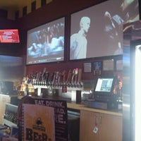 Photo taken at Buffalo Wild Wings by Manolo L. on 10/11/2011