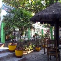 Photo taken at Ayam Goreng Bu Hartini by Fauzia S. on 8/17/2012