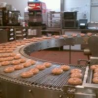 Photo taken at Krispy Kreme Doughnuts by Chris on 1/22/2012