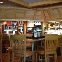Photo taken at Village Tavern by Anastasia E. on 7/6/2012