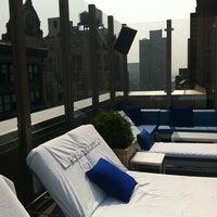 Photo taken at Plunge Rooftop Bar & Lounge by Nikita W. on 7/21/2011