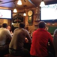 Photo taken at Sláinte Irish Pub by Ben C. on 4/6/2012