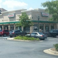 Photo taken at Krispy Kreme Doughnuts by Tiffany B. on 8/13/2012