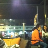 Photo taken at Starbucks Coffee by Giannina P. on 6/9/2012