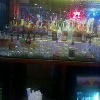 Photo taken at JP Looneys Sports Bar and Grill by J E. on 9/12/2011