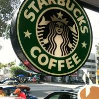 Photo taken at Starbucks by Carolina A. on 7/9/2012