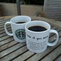 Photo taken at Starbucks by sirirat t. on 12/14/2011