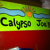 Photo taken at Calypso Joe's Caribbean Grille by Kasey S. on 6/17/2011