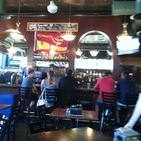 Photo taken at Three Dogs Tavern by Emily B. on 9/10/2011