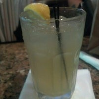 Photo taken at Smokey Bones Bar & Fire Grill by Cory C. on 8/18/2012