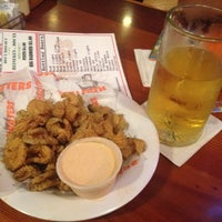 Photo taken at Hooters by Claudia M. on 7/28/2012