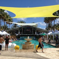 Photo taken at The Pool Parties at The Surfcomber by Daniel R. on 3/18/2012