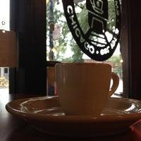 Photo taken at Emerald City Coffee by Derek Q. on 8/13/2012