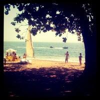 Photo taken at Praia do Curral by Mário E. on 7/25/2012