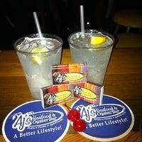 Photo taken at AJ's Seafood & Oyster Bar by Deborah L. on 7/22/2011
